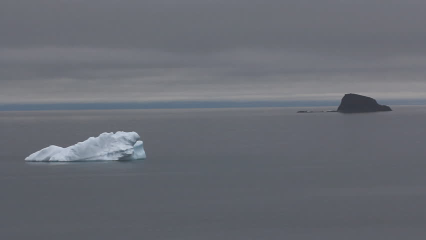Black and white icebergs drifting in waters of Arctic ocean (to North from Franz-Joseph Land). Different danger to ships in foggy calm weather #20587222
