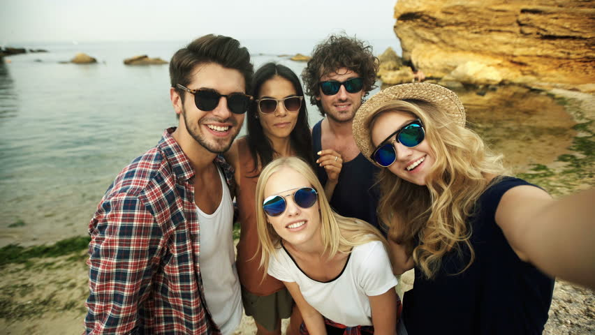 Funny friends in sunglasses taking selfies. | Shutterstock HD Video #20597122