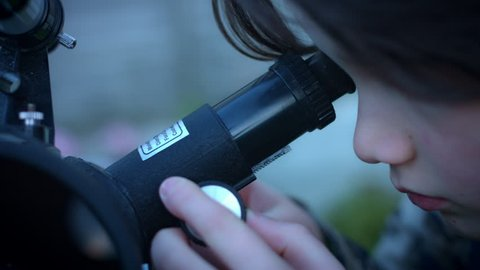 4k Technology and Astrology Child with Binoculars and Telescope, close-up