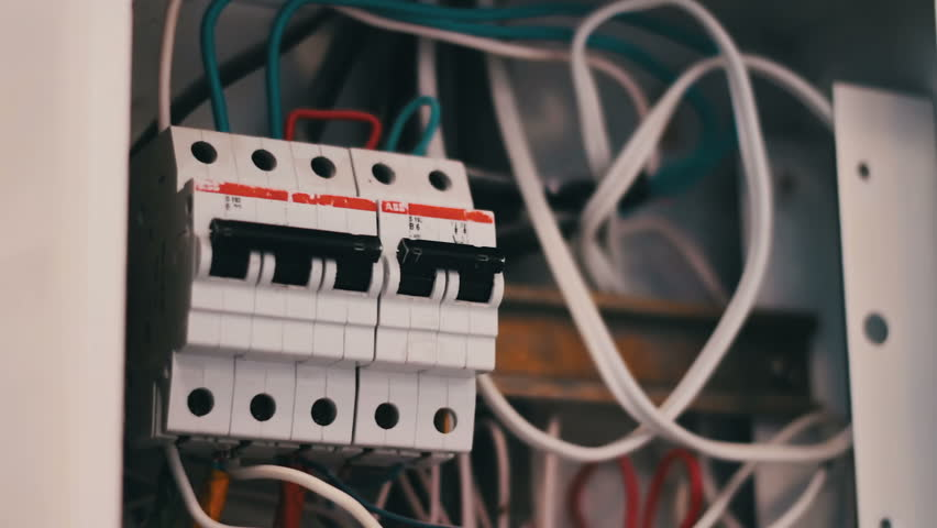 switching electric breaker box man stock footage video (100 Electrical Fuses Small to Largest switching electric breaker box man hand turns on and off electricity power fuse circuit in the panel switching electrical machines in different positions