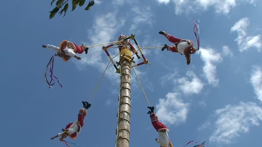 Voladores de papantla ritual indian dance reconstruction. Mexico, Rivera Maya - 2016.