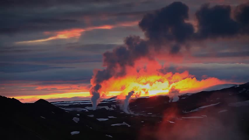 colorfull sunset above a geo-thermal power-plant in a valley in the West of Iceland