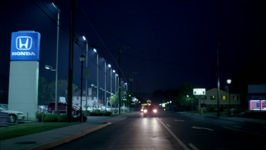 Night Process Plate Straight back smaller city street lined car dealerships small businesses | Shutterstock HD Video #20694256