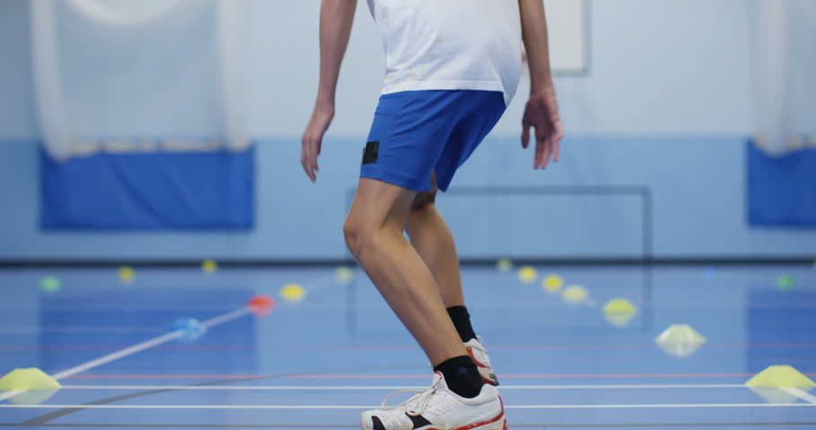 4K Determined young boy running laps & working hard in school P.E. class | Shutterstock HD Video #20695726