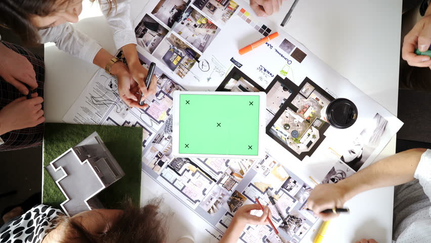 Business, people, architecture and team work concept - close up of architects team hands pointing finger to blueprint at office table 4k | Shutterstock HD Video #20730838