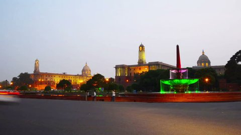 Illuminated Rashtrapati Bhavan an Parliament building in Delhi, India. Time-lapse of car traffic trail lights. Dark sunset sky