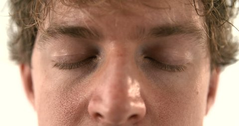 Waking up from Nightmare scary dream eyes closed dreaming rem sleep man 4K UHD. Close up eyes waking man dreaming scared of nightmare. awakening. 4K Ultra HD.