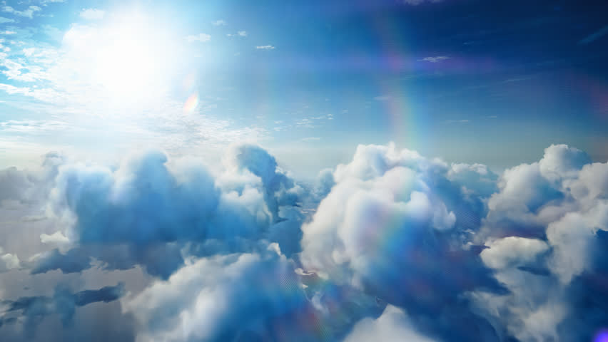 Flying over the timelapse clouds with the afternoon sun. Seamlessly looped animation. Flight through moving cloudscape with beautiful lens flare. Traveling by air. Perfect for cinema, background