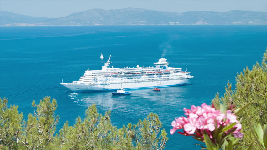 KUSADASI, TURKEY - 2016: Turkish Cruise Industry with Ship Visiting the Vibrant Aegean Sea Resort Town featuring Scenic Mediterranean Colors during the Summer Season