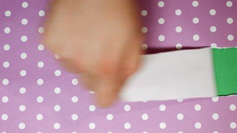 Tear purple polka dot wrapping paper