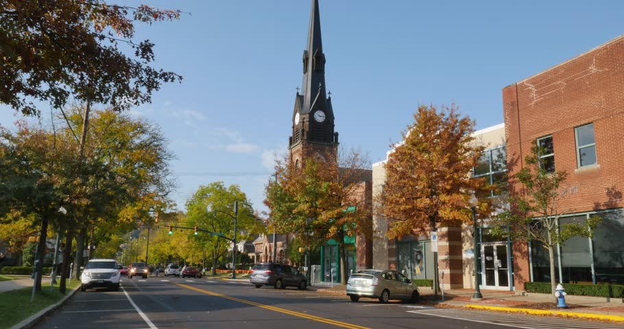 A daytime establishing shot of businesses and a church on a typical Main Street in America. Pittsburgh suburb.