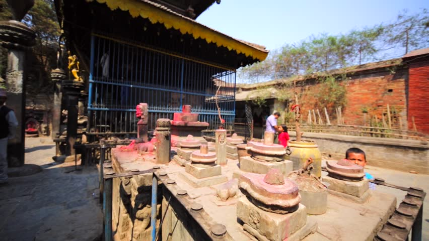 BHAKTAPUR, NEPAL - APRIL 9, 2016: Temple with Lingams. The Lingam is an abstract or aniconic representation of Shiva and seen as a symbol of the energy and potential of Shiva himself