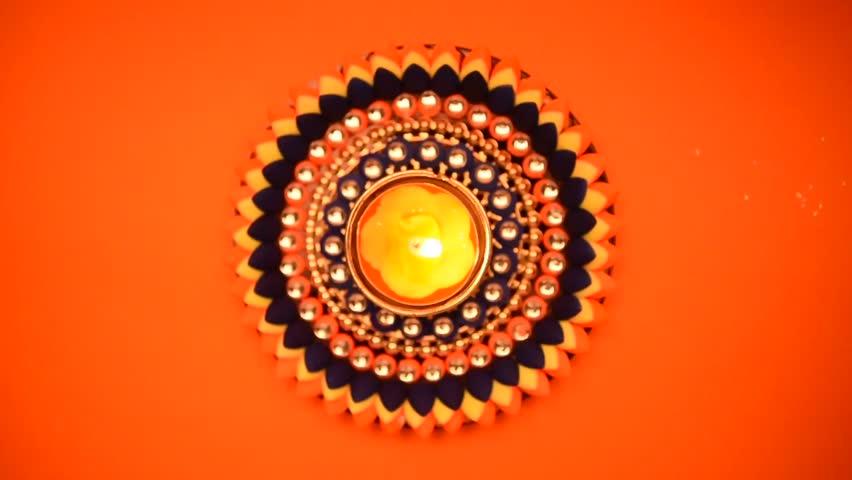 Decorative drawings called Rangoli designs around Diwali lamp during Diwali festival, Mumbai, Maharashtra, India, Southeast Asia. | Shutterstock HD Video #20856997