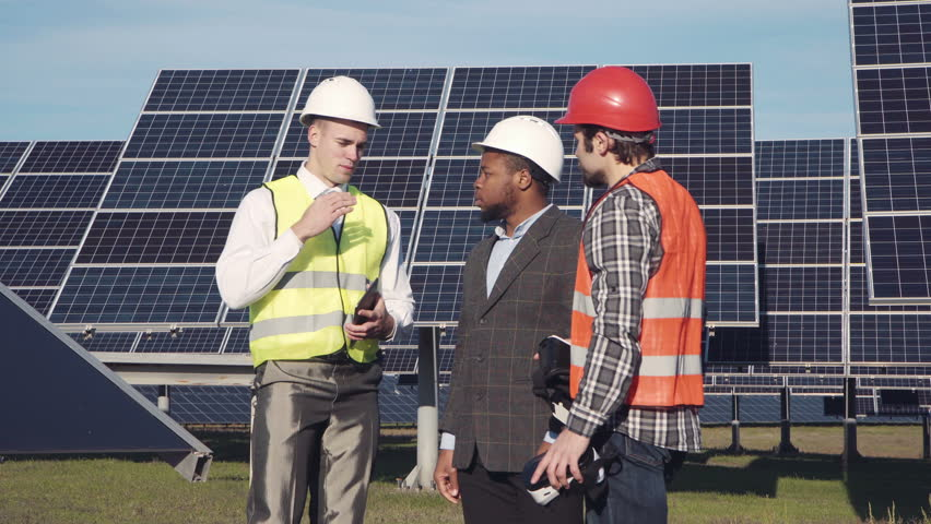 Three mixed race engeneer standing in solar power station and using virtual reality glasses. Copyspace. | Shutterstock HD Video #20858185