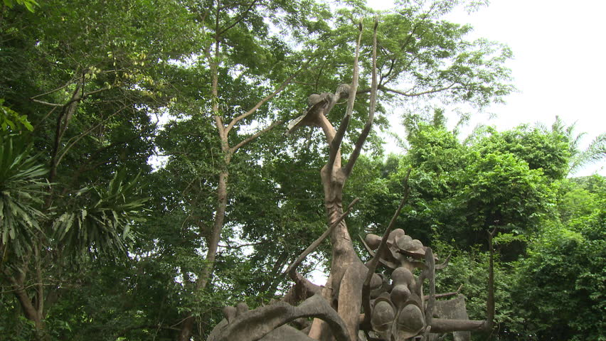 Osogbo, Nigeria - August 2013;Tilt down spiky tangled statue in Sacred Grove.