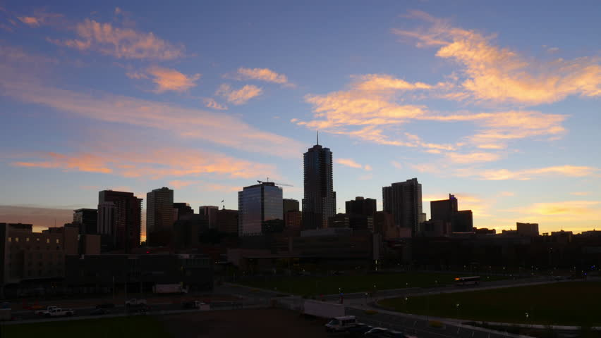 Unique view of the downtown Denver skyline, during a slow, subtle sunrise. 4K UHD timelapse.