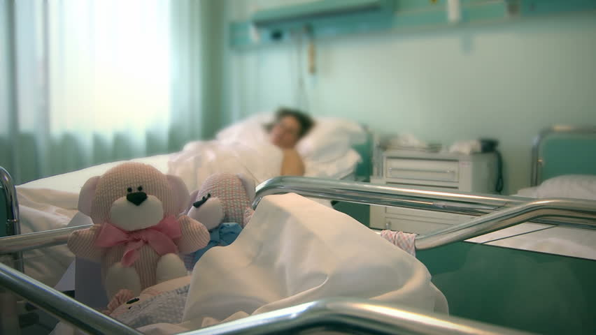 Newborn infant in maternity hospital with mother