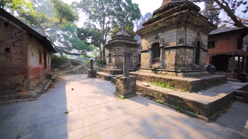 The Pashupatinath Temple with small Shiva temples with lingams. Statue of calf. It's a famous, sacred Hindu temple dedicated to Pashupatinath and is on UNESCO World Heritage Sites's list since 1980