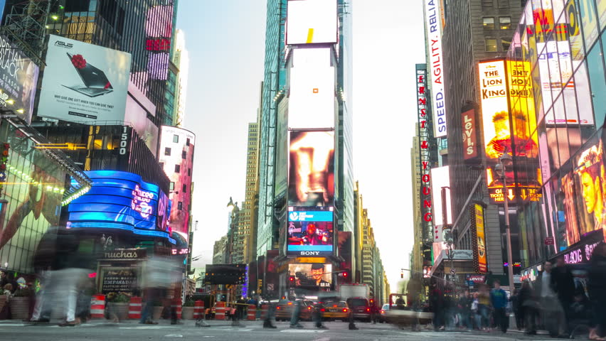 NEW YORK CITY - April 14, 2014: Times Square. Zoom out, from day to night. Crowded street and traffic at the most famous commercial intersection and neighborhood in Midtown Manhattan. United States.    Shutterstock HD Video #20991376