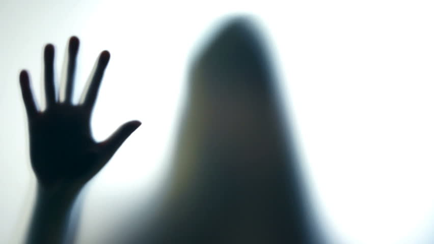 Hysterical crazy woman pounding on glass, spooky silhouette, horror scene. Scary ghostly creature behind the glass | Shutterstock HD Video #20991646