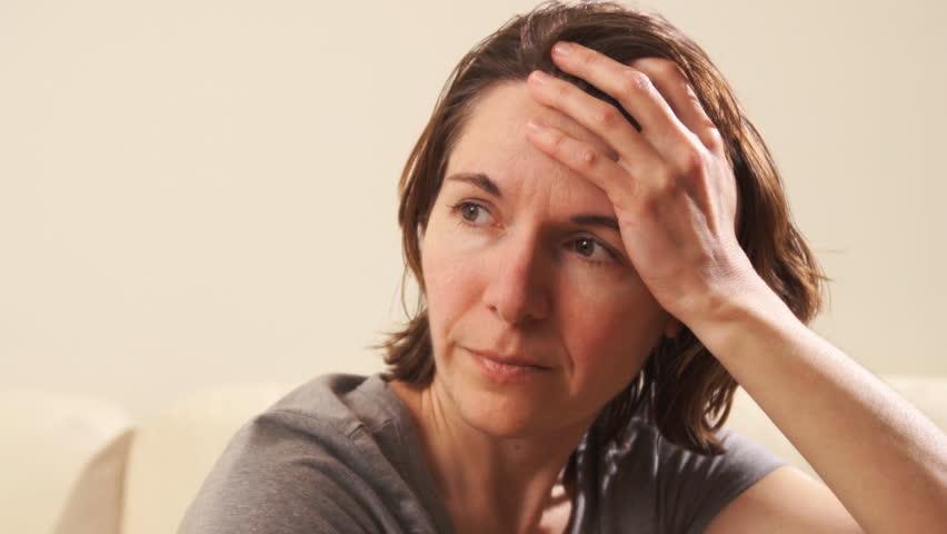 Woman having depression and headache.