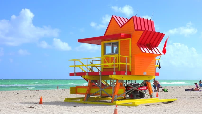 lifeguard tower in a typical colorful art deco style on a bright sunny summer day  with blue sky