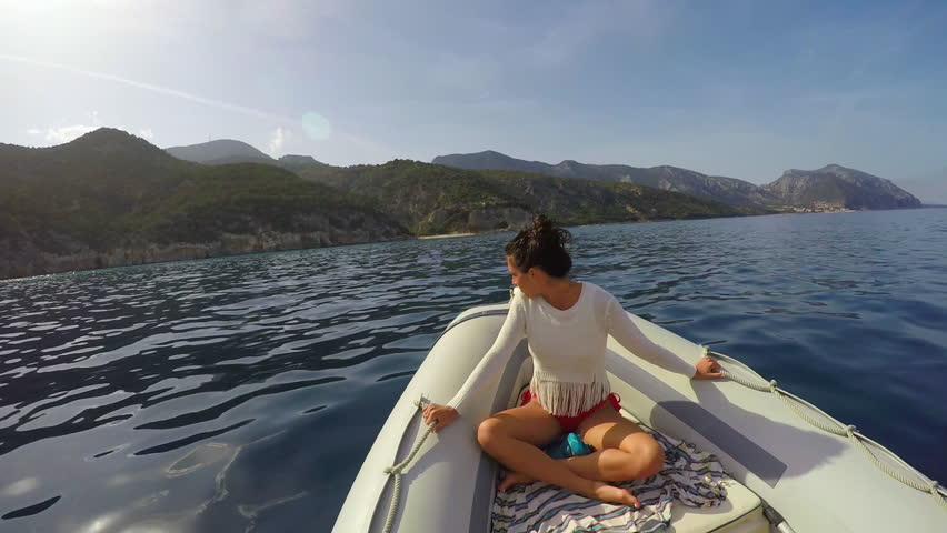 Beautiful happy girl riding in speed boat freedom on destination travel adventure vacation #21028306