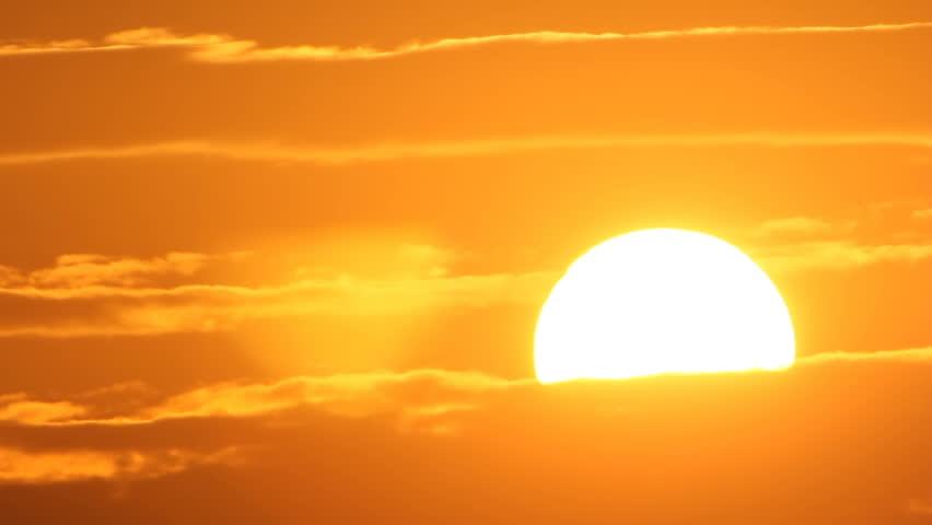 Dazzling sunset sun through clouds