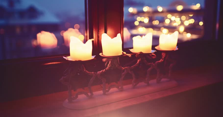 Christmas Candles Burning on the window, Quiet Snowy Winter Neighbourhood Background. 4K DCi SLOW MOTION 120 fps. Snowfall on Xmas Eve. Winter Holidays Concept. Advent Traditions. DOLLY SHOT #21039883