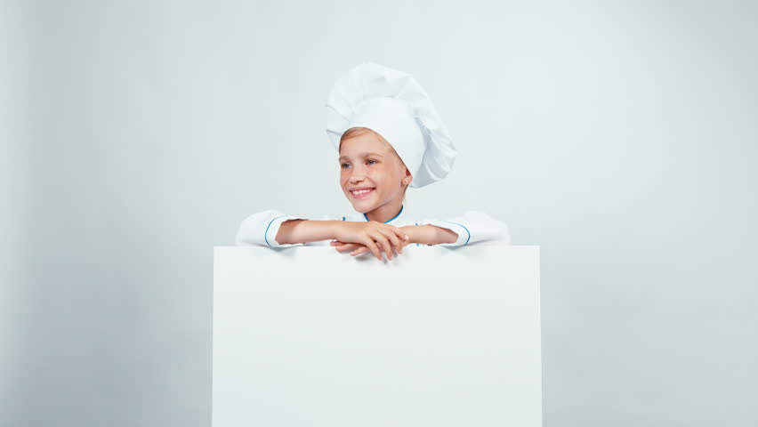 Little chef cook with white board isolated on white smiling at camera | Shutterstock HD Video #21083956