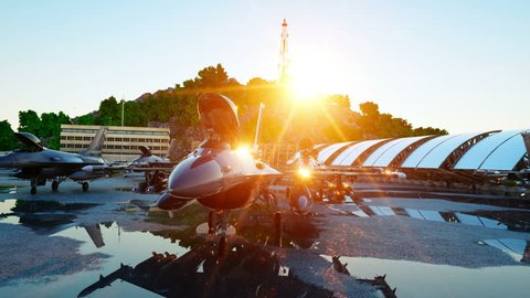 f 16 military fighter jet. military base. sunset. 3d animation.