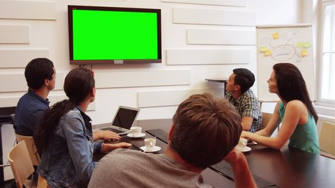 Business executives doing a video conference in the conference room 4k