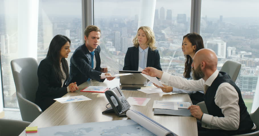 4K International business team looking at paperwork with demographics in city office | Shutterstock HD Video #21099046