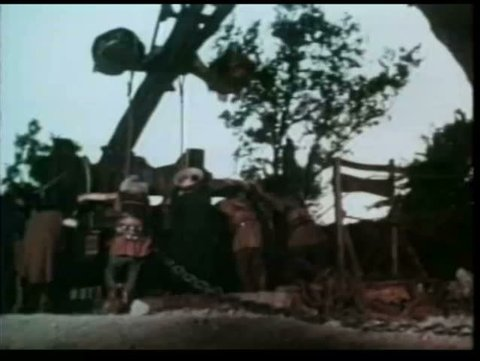 Barbarians loading catapult with explosive device and firing