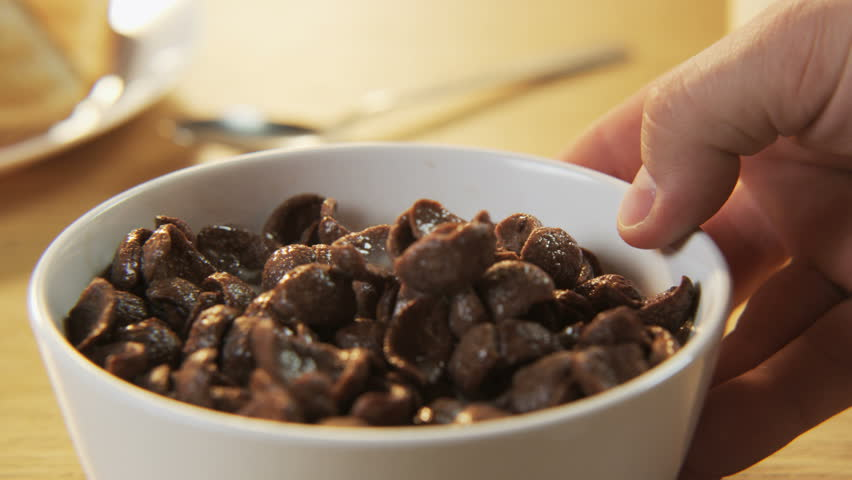 lighting a bowl. A Man Takes Bowl With Chocolate Flakes - 4K Stock Video Clip Lighting H
