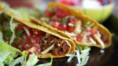 Hard shells beef taco with salsa sauce. Popular Mexican food