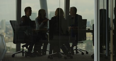 4K Business team having heated discussion boardroom meeting in city office. Slow motion.
