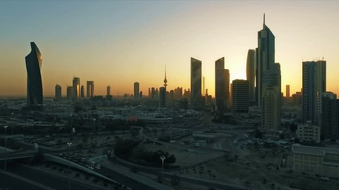 Kuwait skyline at sunset aerial. Some famous places in Kuwait shooting from the sky. Skyscrapers, towers and traffic on the road