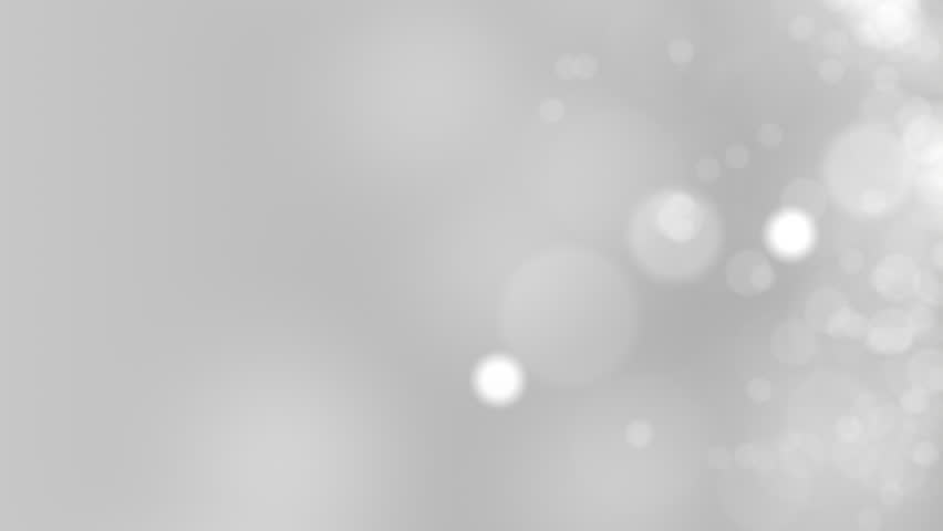 Grey motion background. Abstract glowing bokeh circles or sparks. 8K seamless loop clip | Shutterstock HD Video #21223846