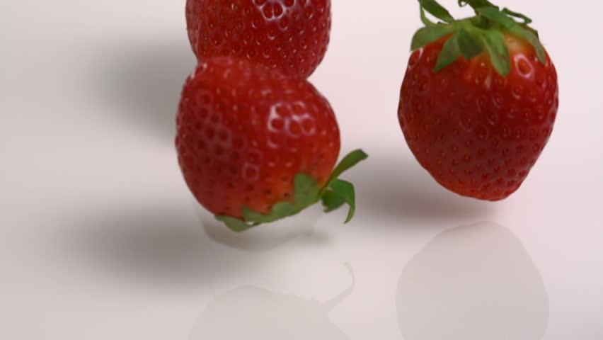 Slow-motion strawberry into milk