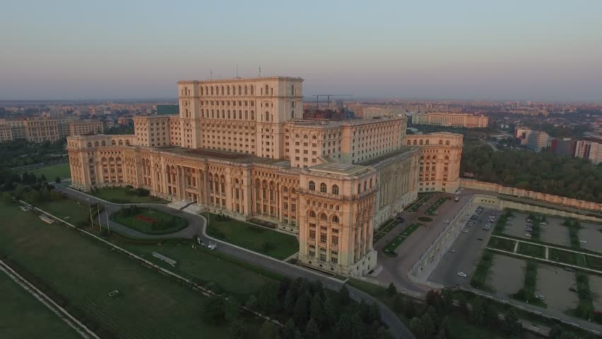 Dawn 4K Drone Shot Of The Palace Of The Parliament in Bucharest, Romania. This is the second largest administrative building in the world, and also the third largest building in the world.