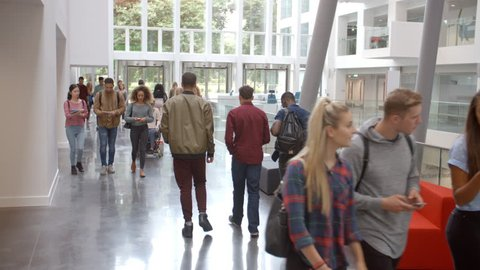 Students walk through the foyer of a modern university