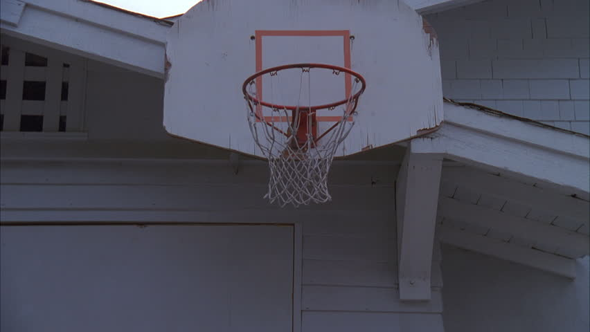 Basketball goes into hoop stock footage video 7254595 for Basketball garage