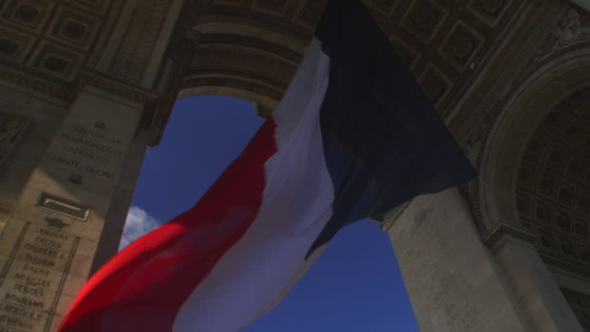 Time lapse, Low angle view of flag under Arc de Triomphe, Paris, France