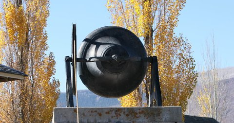 Historic school bell rings for Veterans Day celebration. Small patriotic rural community. Children ring bell in memorial to those who have served and gave their all through death protecting the USA.