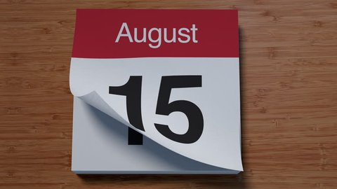 Calendar for August on wooden table flipping through days of month