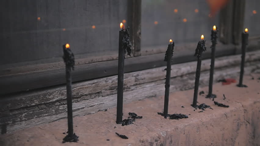 Black candles burn smoothly. The decor in an abandoned building. | Shutterstock HD Video #21363448