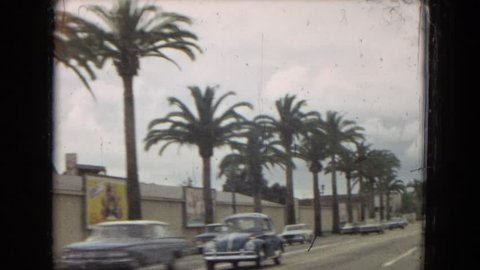 CALIFORNIA 1967: driving down the busy streets in a new lincoln town car