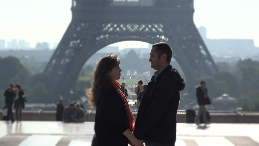 Man and woman holding hands close to Eiffel tower, romantic dating   Shutterstock HD Video #21397486