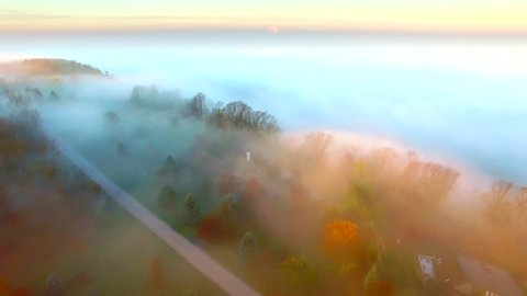 Surreal Autumn flight over foggy cliffs at the edge of the world.
